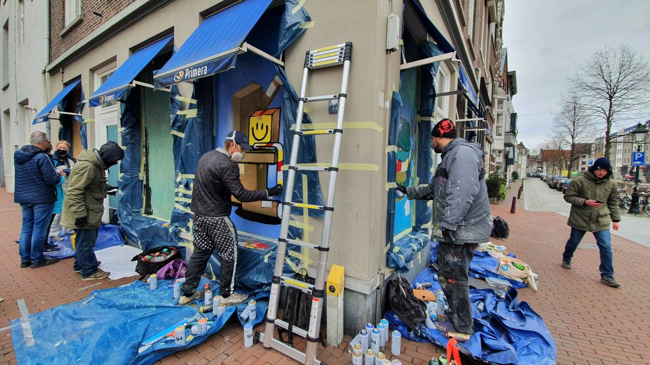 "Crowded shops lit up with graffiti: ""Den Bosch always comes from the swamp, just like Oetels."""