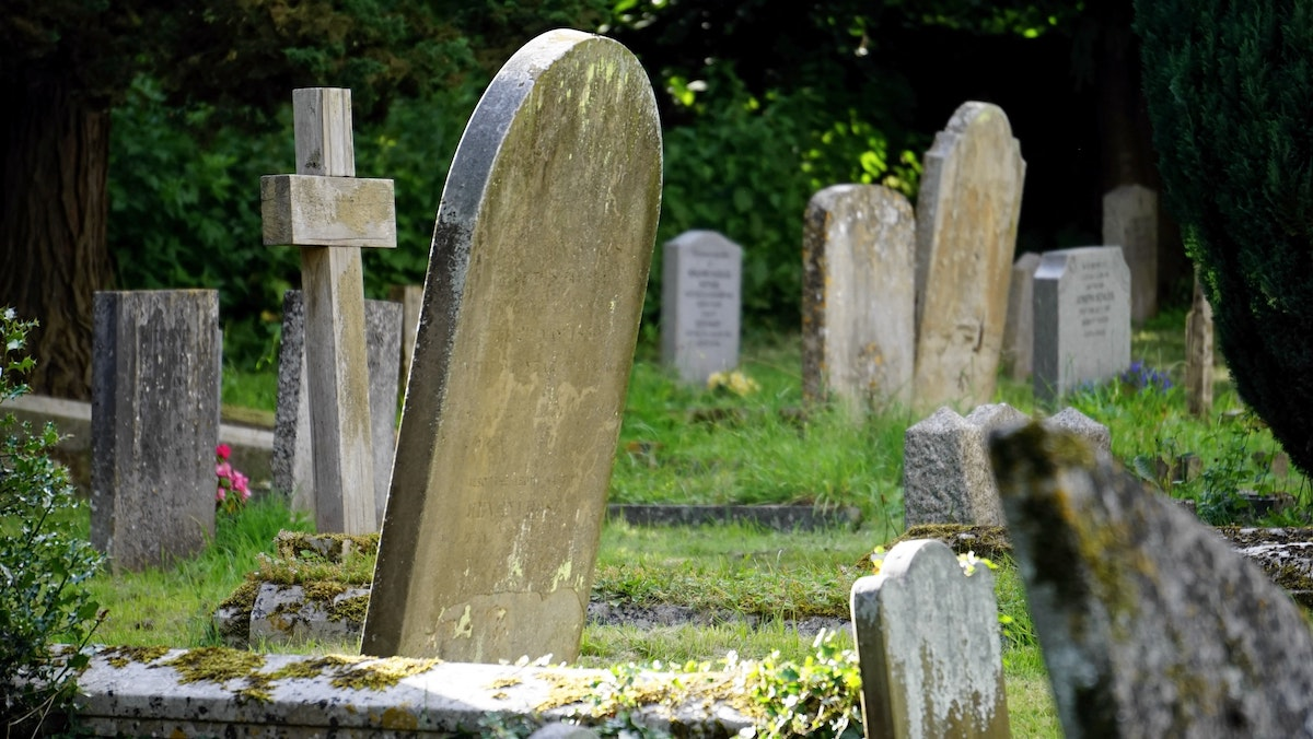 A grave digger abuses a backward woman in the cemetery