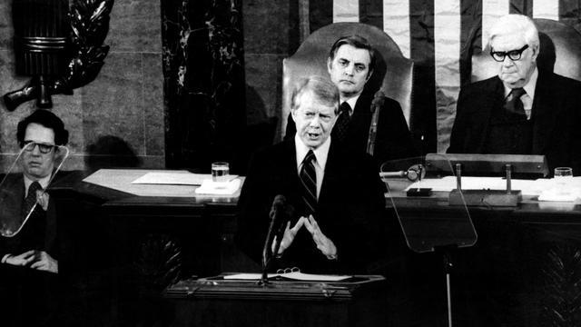 Walter Mundell (center) speaks to the Senate by President Jimmy Carter in 1977.