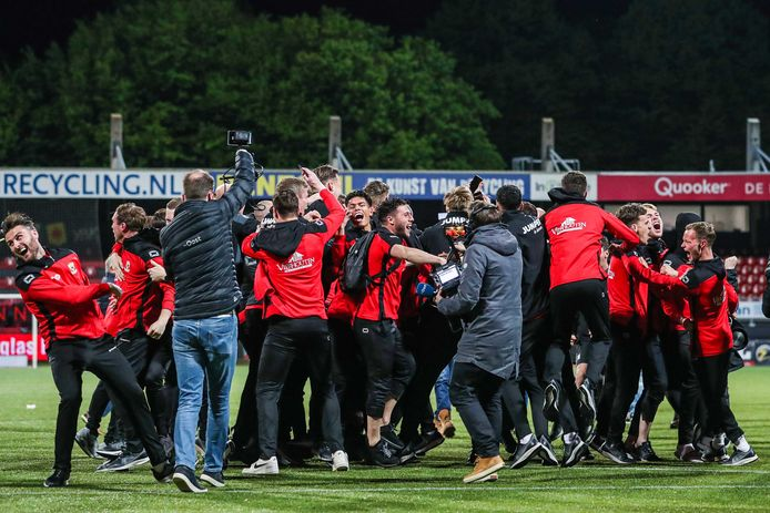 Go Ahead players celebrate after they've been promoted.