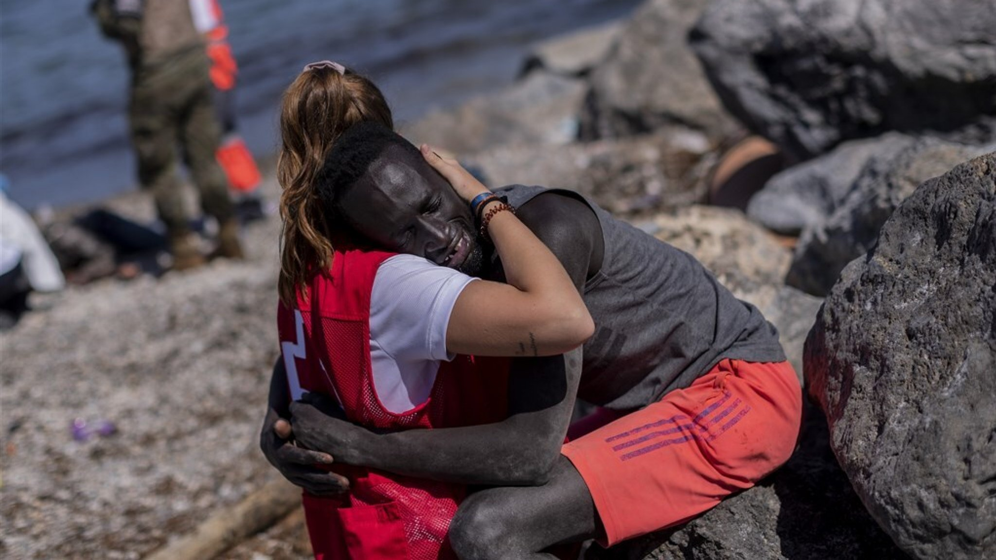 Aid worker consoles a refugee near Ceuta: 'a symbol of hope'