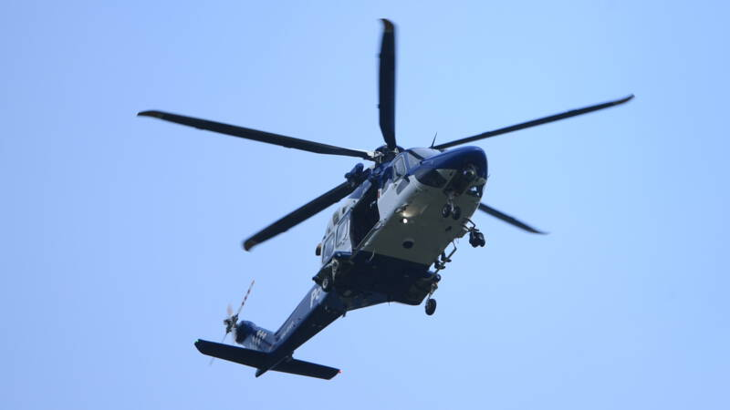 The New Zealand fugitive arranges a helicopter to surrender