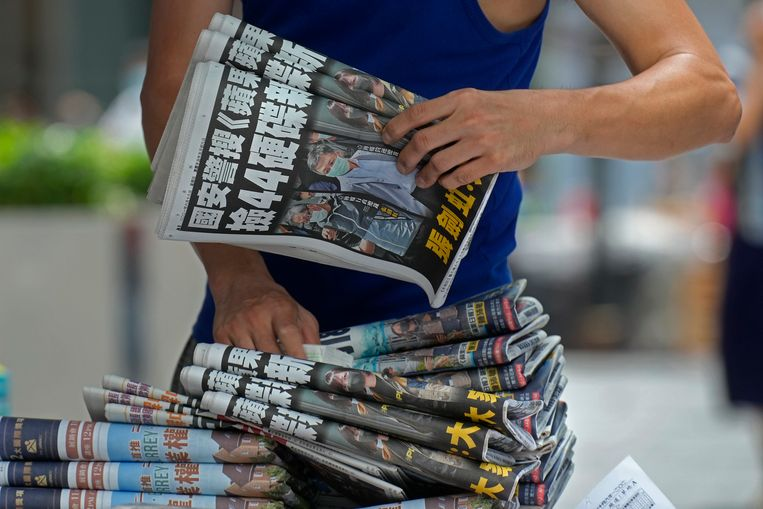 A traveling salesman with a large collection of Apple Daily copies.  AP . image