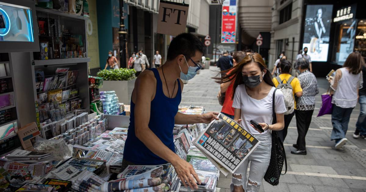 Hong Kong pro-democracy newspaper comes a day after raid with extra wide spread    abroad