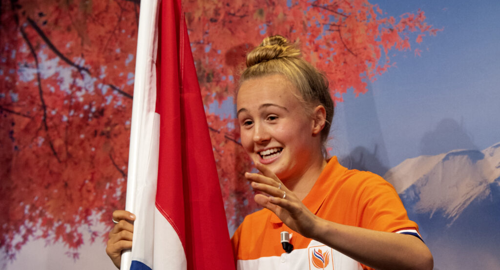 Kate Oldenbuffing (16) holds the Olympic flag: who is she exactly?