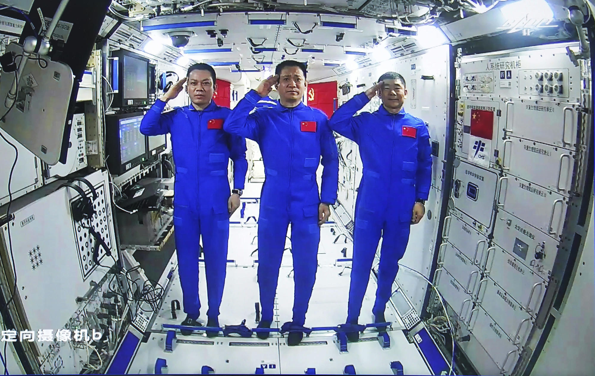 Chinese astronauts walk in space outside the new station for the first time