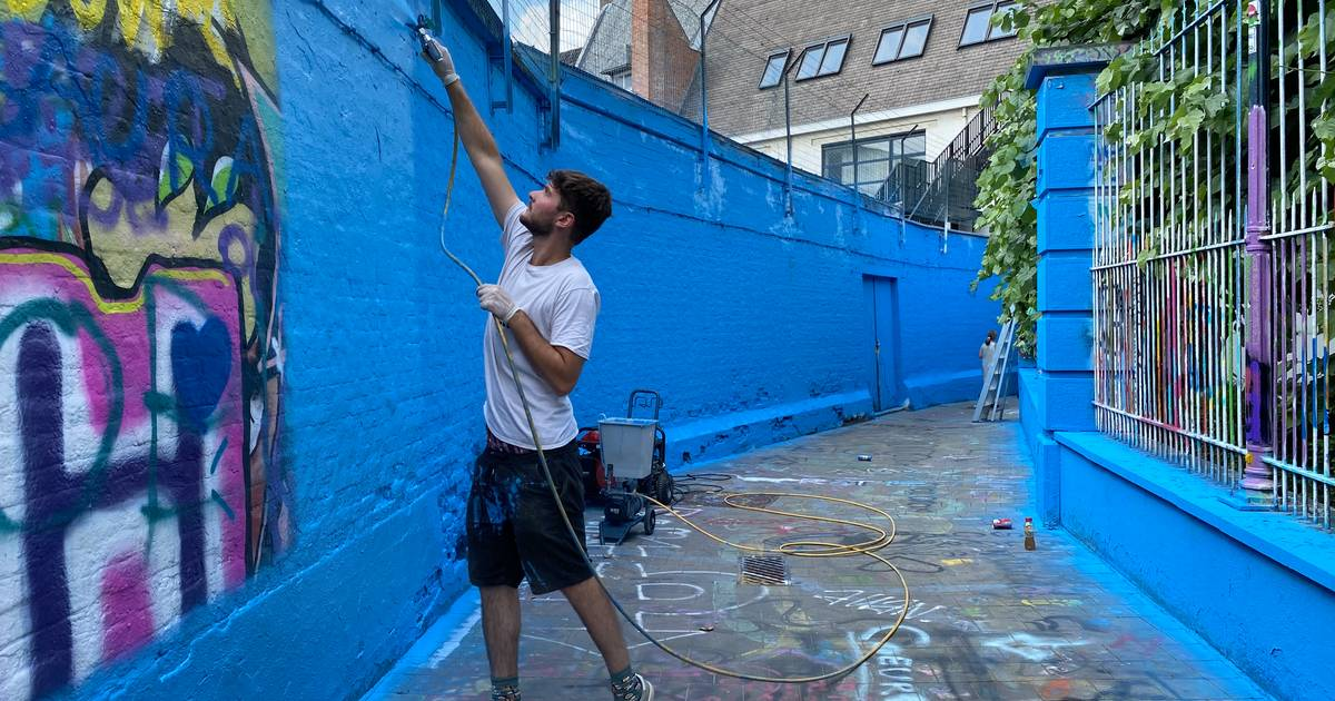 """Graffiti Street is all painted blue: """"Just as a reminder that this is a public space and no one can claim a piece of the wall"""" 