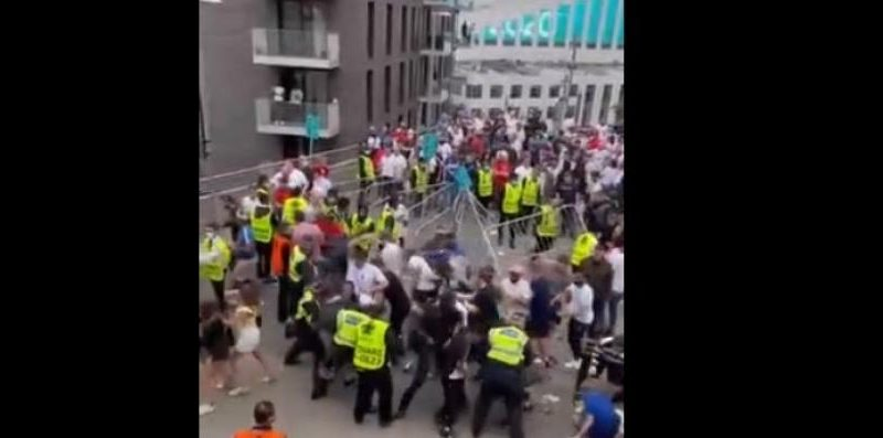 Live - European Championship final - Chaos at Wembley Dozens of fans try to raise barriers after violent clashes before the match