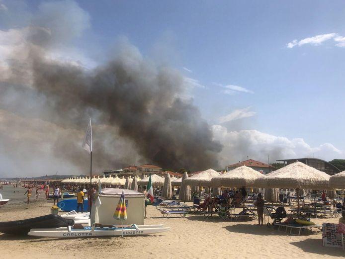 Beachgoers in Pescara watch smoke billowing from the Dannunziana Reserve.
