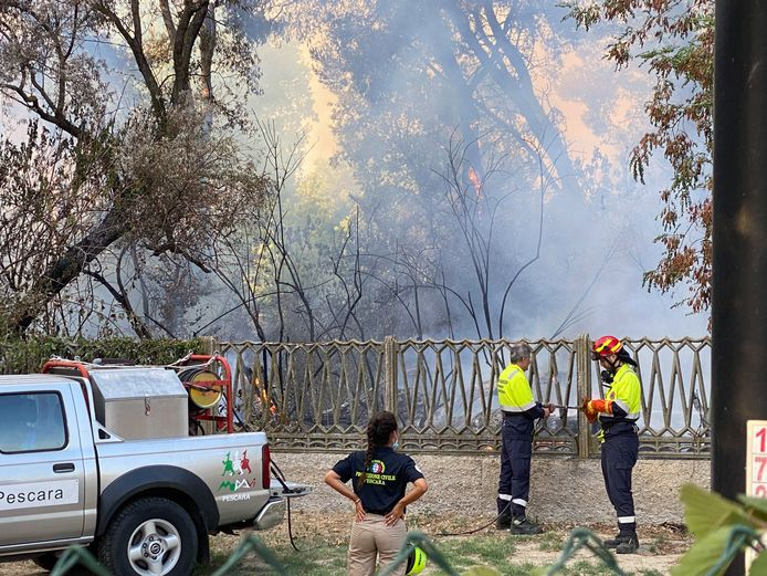 Firefighters battle a blaze in the Pineta d'Annunziana Nature Reserve in Pescara.