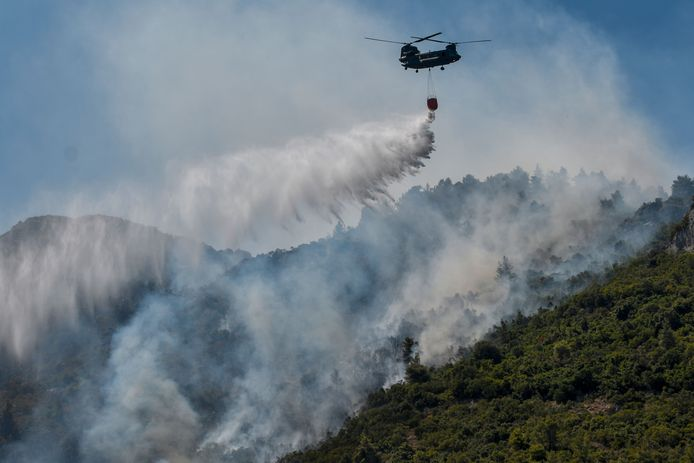A Chinook helicopter drops water on a forest fire near Malakasa, north of Athens.